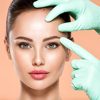 Face skin check before plastic surgery. Beautician touching youn